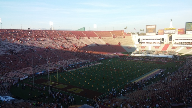 The band takes the field and the stadium is still more than half empty